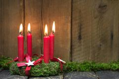 Advent or christmas wreath with four red wax candles. Stock Photos