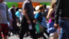 Loop of defocused crowd of people on city street at pedestrian crosswalk Stock Footage