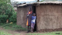 Mother and son. Maasai village. Kenya. Stock Footage
