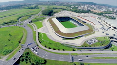 Stadium and busy road from air Stock Footage