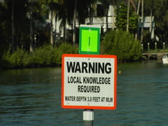 "Sign ""Warning local knowledge required"" Stock Footage"