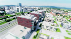 Flying next to business buildings complex tilt-shift effect Stock Footage