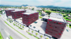 Aerial shot of four identical business buildings with tilt-shift effect Stock Footage