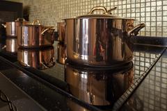 Copper cookware in a row Stock Photos