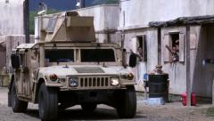 US Marines HMWVE Drives Through Street Stock Footage