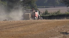 Agriculture Farming Tractor Making Straw Bales Stock Footage