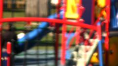 Children's playground or schoolyard, filmed out-of-focus for anonymity. Stock Footage