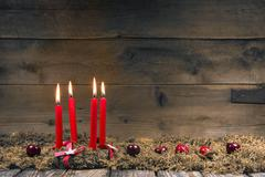 advent or christmas wreath with four red wax candles. - stock photo