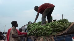 Offloading banana truck in uganda Stock Footage