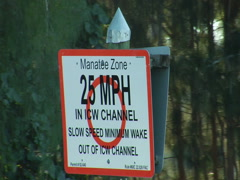 """Sign """"Manatee Zone 25 mph"""" 01 - stock footage"""
