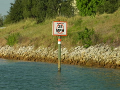 """Sign """"Manatee Zone 25 mph"""" 02 - stock footage"""