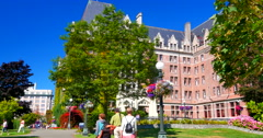 4K Tourists on Side Path, Side Path, Empress Hotel in Summertime Stock Footage