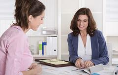professional business meeting under two woman: client and adviser. - stock photo