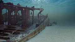 Underwater shipwreck loop animation. Sunken ship on the sea floor. Stock Footage