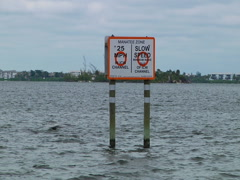 """Sign """"Manatee Zone 25 mph"""" - stock footage"""