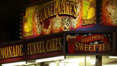 Carnival Vendor - Funnel Cakes - stock footage