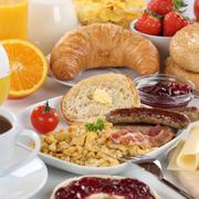 Big breakfast with orange juice, cheese, fruits and scrambled eggs Stock Photos
