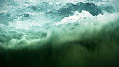 Seamless loop. Ocean waves. Slow motion. Stormy sea water splashes on glass. Stock Footage