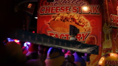 Carnival Vendor - Cheese Steak Stock Footage