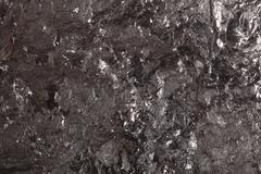 Black bituminous coal, carbon nugget background Kuvituskuvat