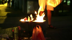Hong Kong Ghost festival burning of joss paper                          Stock Footage