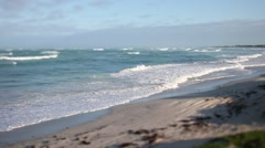 Deserted beach with swell - tilt shift - stock footage