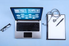 computer laptop, stethoscope and clipboard - stock photo