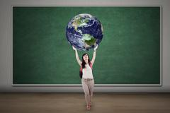 Female student is holding globe Stock Illustration