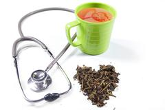 Green tea and stethoscope Stock Photos