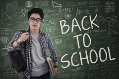 Student gives command for back to school Stock Photos