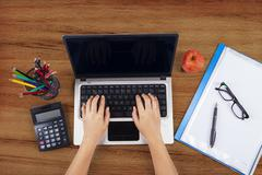 Student hands typing on laptop Stock Photos