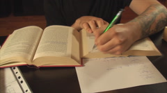 Tattooed Student Studying Late At Night, Cross Referencing, Exams, Front Shot Stock Footage