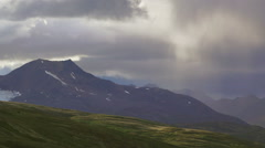 Ponderous Rainstorm over Mountain Tundra in Canada TL HD Stock Footage