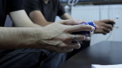 Lazy College Boys Playing On A Game Console, Hands Detail, Side Shot Stock Footage