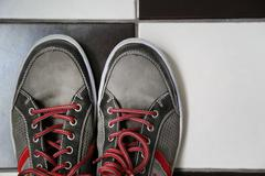 cropped image of gray shoes with vivid red laces - stock photo