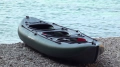 Canoe and man on the beach zoom out Stock Footage