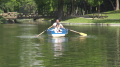 Grandfather with nephews, father with children on lake, sailing a boat, paddle Stock Footage