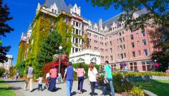 4K Tourists Passing in Front of Empress Hotel, Tilt Shot Stock Footage