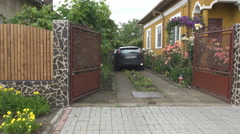 Beautiful house yard, car going out to street new modern home view idyllic place Stock Footage