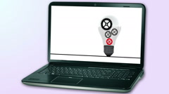 Animated gears in light bulb show on laptop screen Stock Footage