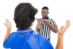 Stock Photo of Serious referee showing time out sign to player