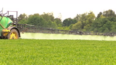 Tractor sprinkler spray field plants with chemical herbicide Stock Footage