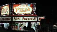 Carnival Vendor - Pizza and Soft Pretzels Stock Footage