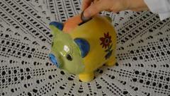 Piggybank and Coins - stock footage