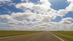 POV Driving Country Roads with Huge Clouds Stock Footage