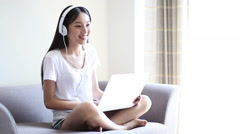 Stock Video Footage of woman listening to music