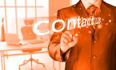 Businessman pushing contact us sign Stock Illustration
