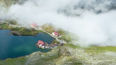 Balea Lake Cabin, Transfagarasan, Fagaras mountains. Romania Timelapse (24fps) Stock Footage