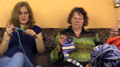 two generations nice spend free time knitting room, focus change - stock footage