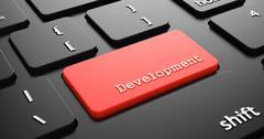 Development on Red Keyboard Button. - stock illustration